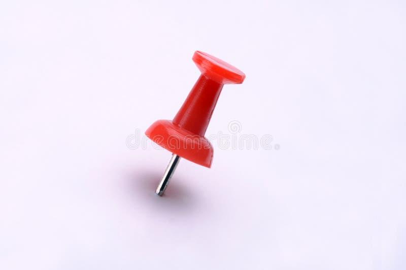 Pin di plastica rosso di spinta immagine stock