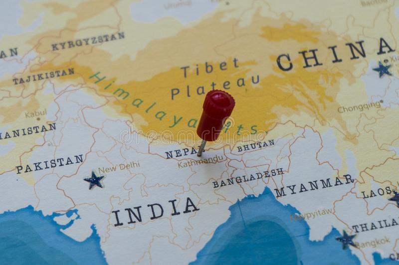 A pin on kathmandu, nepal in the world map royalty free stock photography