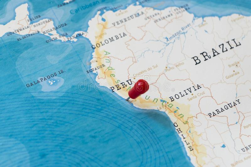 A pin on lima, peru in the world map.  stock photography