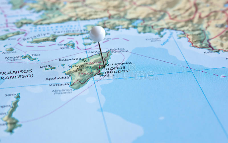 Pin on map with Rhodes island. Greece stock photos