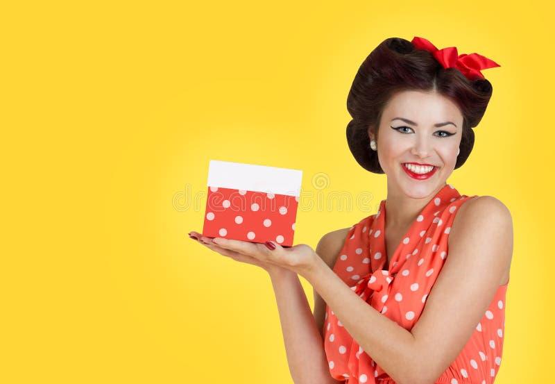 Pin p girl holding a gift box royalty free stock photos