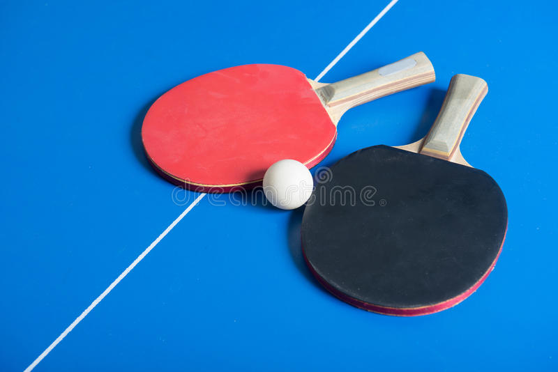 Download Pin Pong Ball And Red Paddle On Blue Board Stock Photo - Image of board, ball: 39500008
