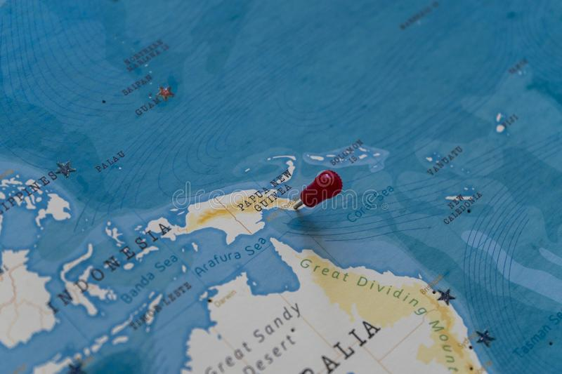 A pin on port moresby, papua new guinea in the world map.  royalty free stock image