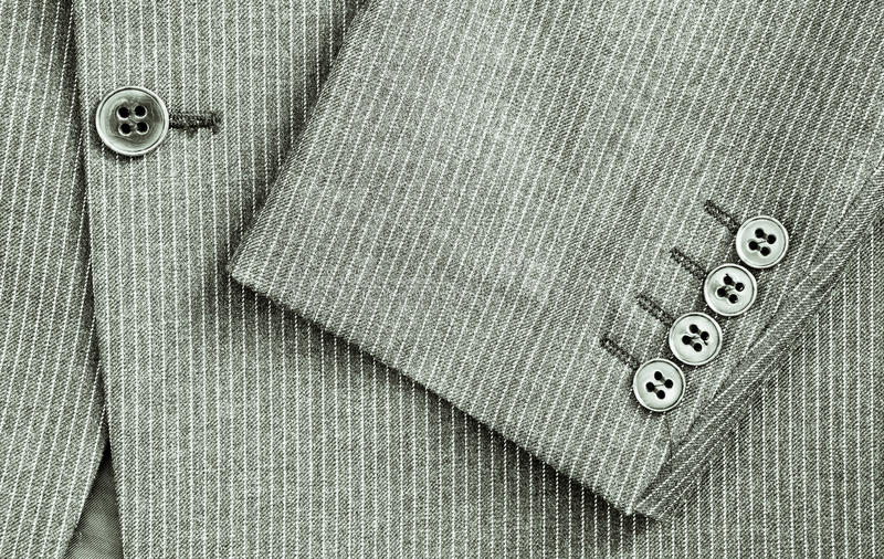 Pin stripe suit. Close up of sleeve and center of a pin stripe suit in black and white stock photos