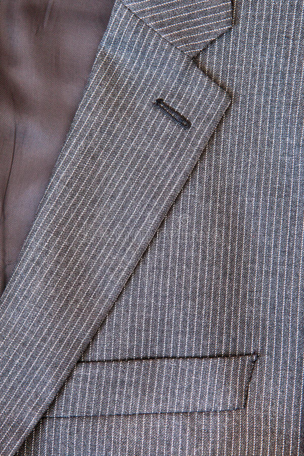 Pin stripe suit. Close up of the collar and breast pocket of a pin stripe suit stock photo