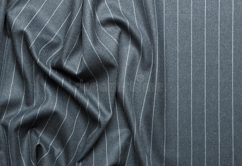Pin striped suit with creases. High quality pin stripe suit background texture royalty free stock photography