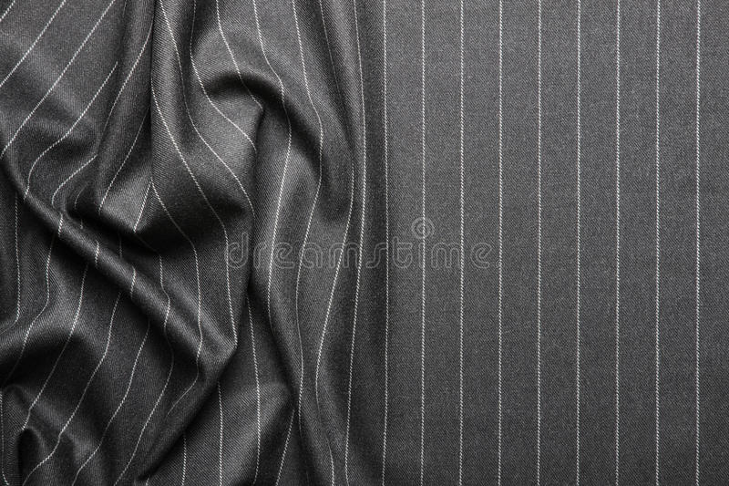Pin striped suit texture. High quality pin stripe suit background texture with folds and copy space royalty free stock photography