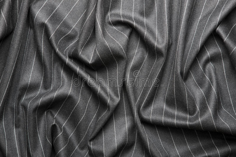 Pin striped suit texture. High quality pin stripe suit background texture with folds stock photography