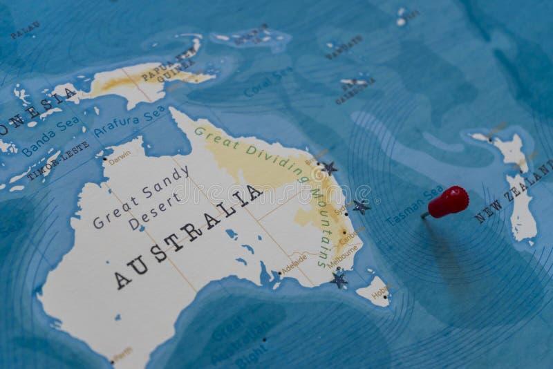 A pin on tasman sea in the world map.  stock image
