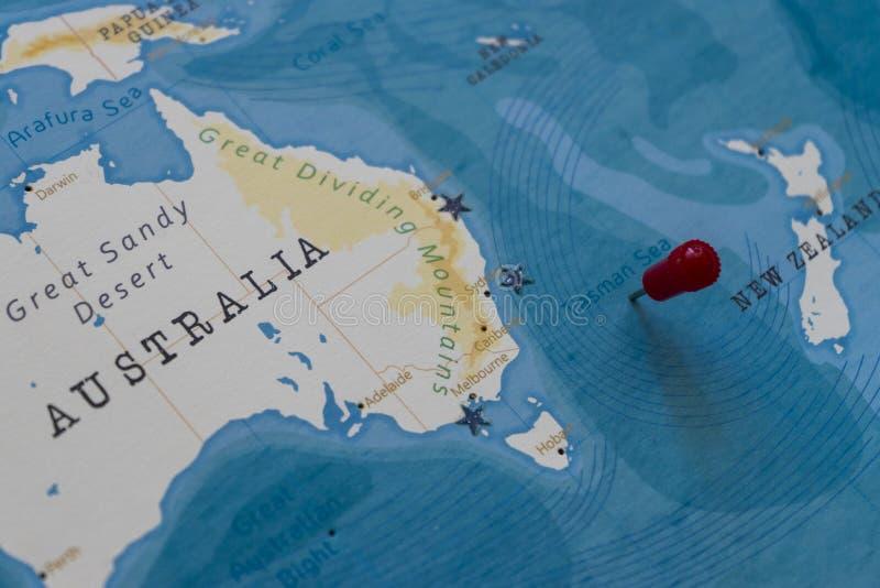 A pin on tasman sea in the world map.  stock photo