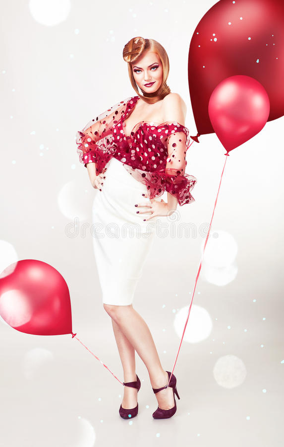 Free Pin Up Blond Woman In Red Blouse Stock Photography - 36977532