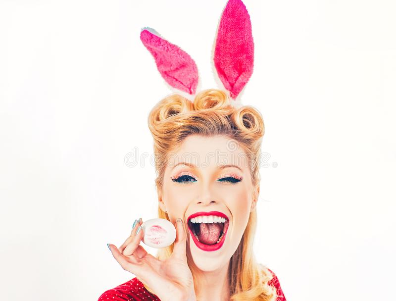 Pin-up Easter. Sexy woman in bunny ears winking. Sweet adorable girl in bunny ears celebrating Easter. Isolated white. Background. Woman wearing Easter bunny stock image