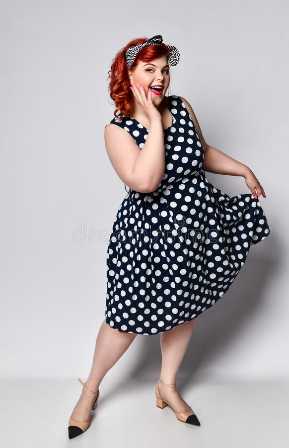 Pin up a female portrait. Beautiful retro fat woman in polka dot dress with red lips and manicure nails and old-style haircut stock illustration