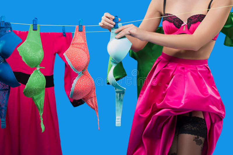 Pin-up girl with a basket with the laundry. Pin-up girl on the background of the ropes with the laundry stock photo