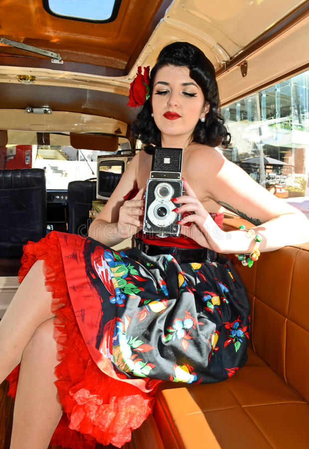 Pin Up Girl With Classic-Camera stock fotografie