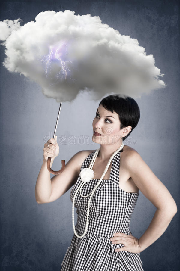 Pin-up girl with cloud umbrella under storm. Y weather stock photos