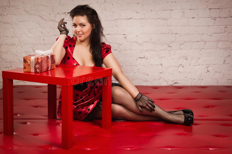 Pin-up girl with gift stock images