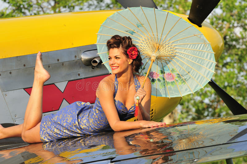 Download Pin Up Girl Posing With A Vintage Fighter Plane Stock Image - Image: 24982605