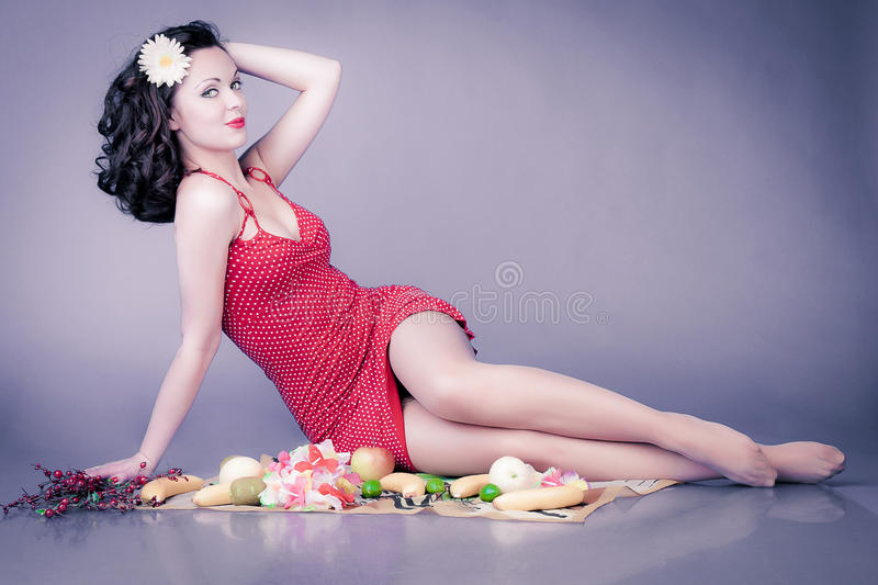 Pin up girl. In red dress on picnic stock illustration
