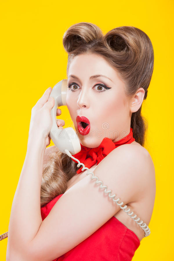 Pin-up Girl Talking On Retro Telephone Stock Photo