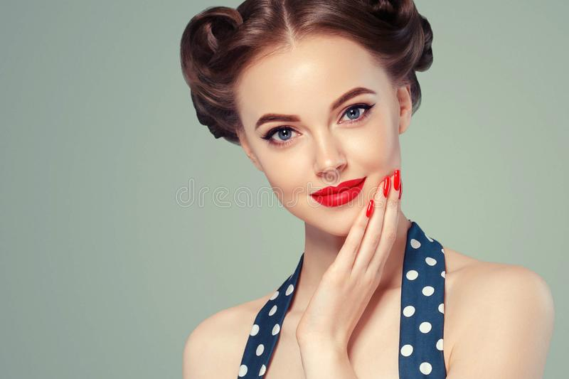 Pin up girl vintage. Beautiful woman pinup style portrait in retro dress and makeup, manicure nails hands, red lipstick and polka stock image