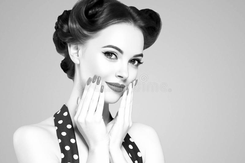 Pin up girl vintage. Beautiful woman pinup style portrait in retro dress and makeup, manicure nails hands, red lipstick and polka stock images