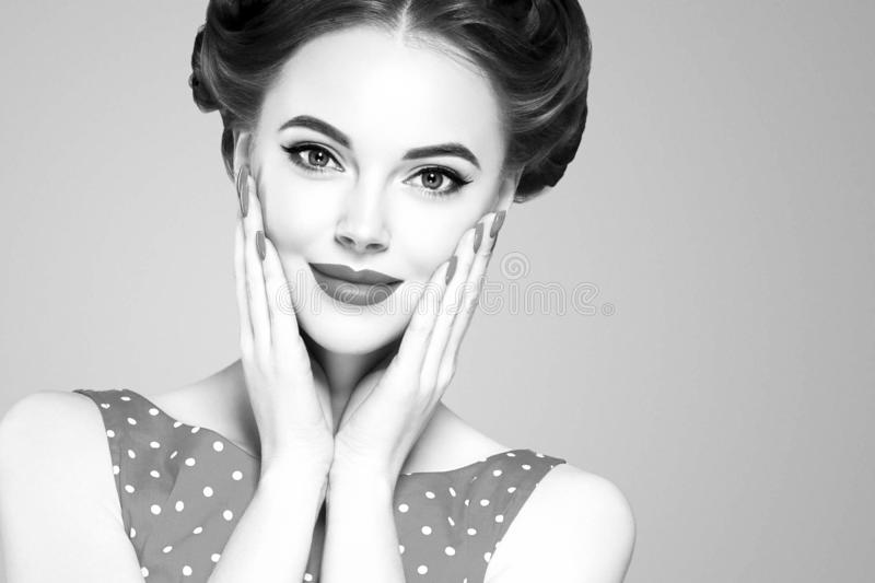 Pin up girl vintage. Wow expressions emotion! Beautiful woman pinup style portrait in retro dress and makeup, manicure nails hands stock image