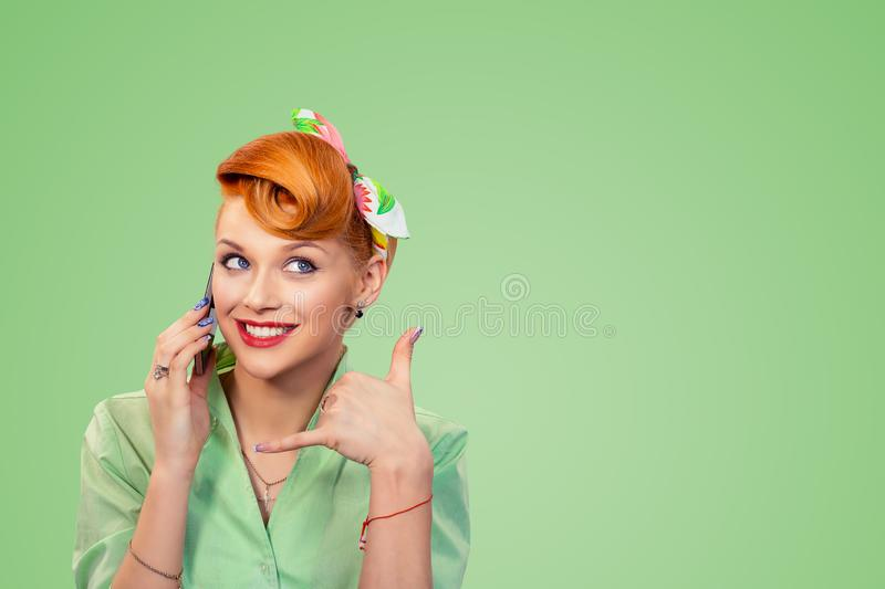 Pin up style girl showing call me sign. Call me. Closeup red head young woman pretty smiling pinup girl in button shirt holding phone showing you call me sign stock image