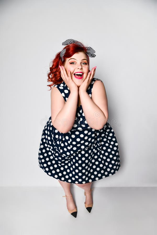 Pin up woman portrait. Beautiful retro female in polka dot dress with red lips and manicure nails and old fashion hairstyle. Cute portrait of a full-length red royalty free stock photos