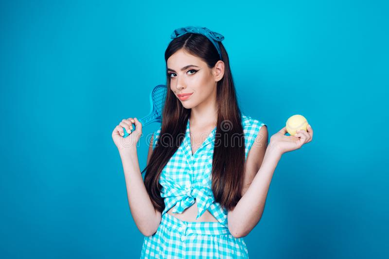 Pin up woman with trendy makeup. retro woman playing tennis. Sport. pinup girl with fashion hair. pretty girl in vintage. Style. health and fitness. Relaxing royalty free stock photography