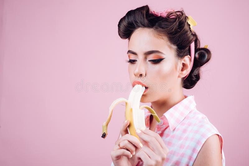 Pin up woman with trendy makeup. retro woman eating banana. pinup girl with fashion hair. pretty girl in vintage style. Banana dieting, copy space. i want you royalty free stock images