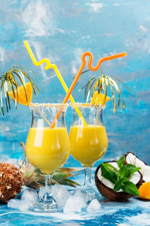 Pina colada cocktail and ingredients stock images