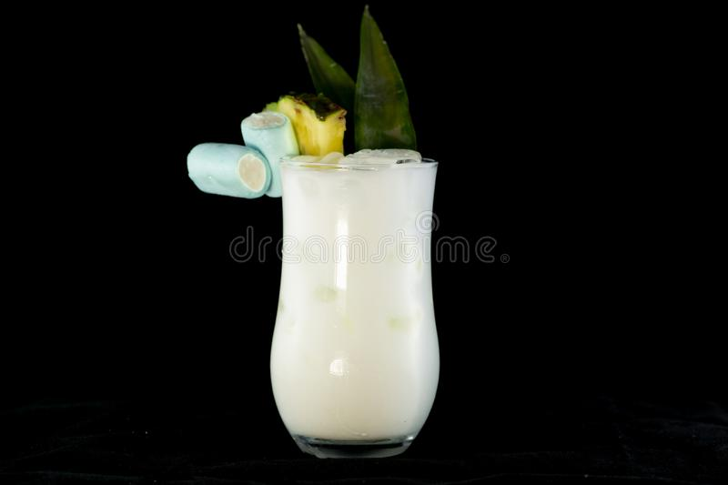 Pina Colada cocktail with pineapple juice, white rum and coconut cream decorated with pineapple fruit and leaf royalty free stock photo
