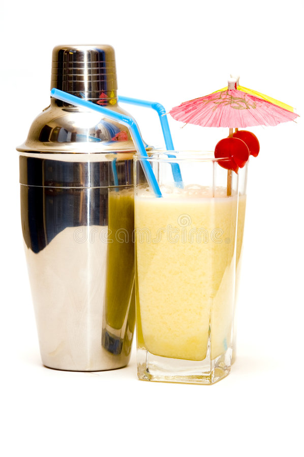 Pina colada cocktail with umbrella & shaker royalty free stock photos