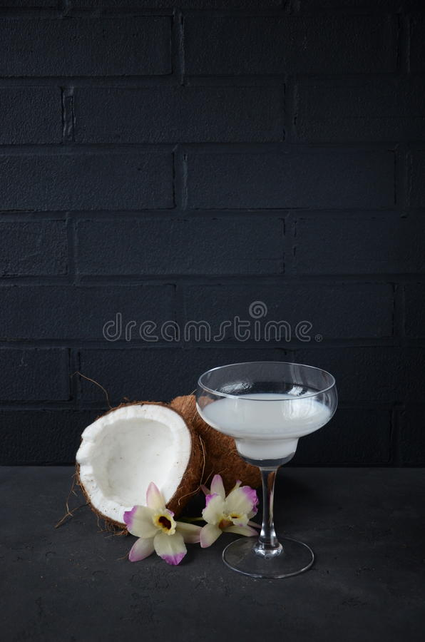 Download Pina Colada Drink In Cocktail Glass Decorated With Coconut And Orchid Flowers Stock Image - Image: 83700881