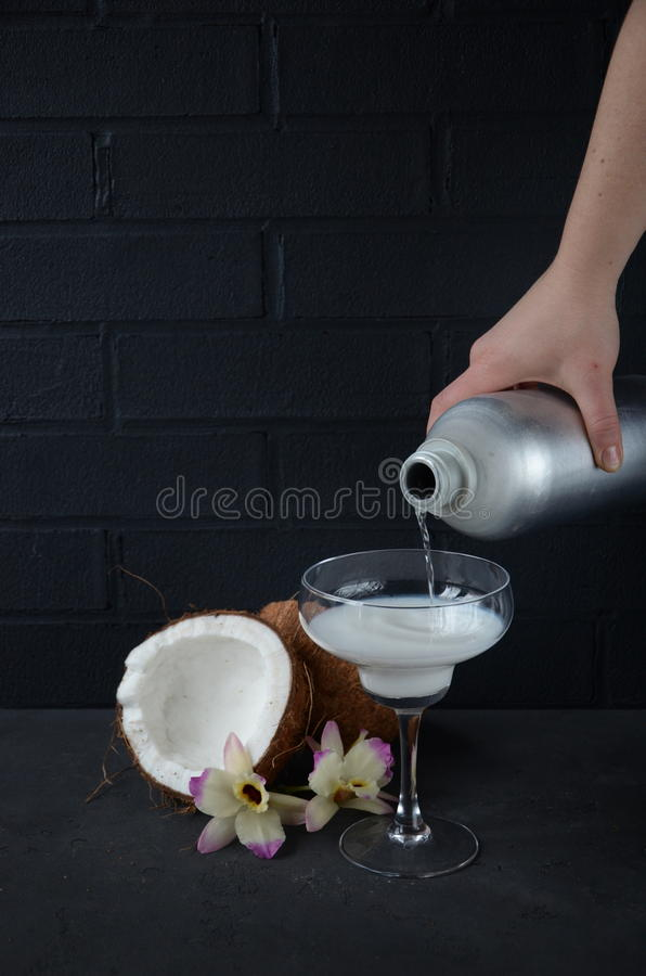 Download Pina Colada Drink In Cocktail Glass Decorated With Coconut And Orchid Flowers Stock Image - Image: 83700917