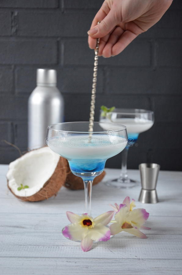 Download Pina Colada Drink In Cocktail Glass Decorated With Coconut And Orchid Flowers Stock Photo - Image: 83701081