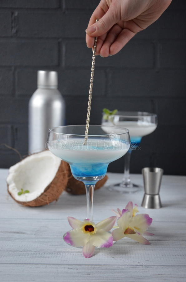 Download Pina Colada Drink In Cocktail Glass Decorated With Coconut And Orchid Flowers Stock Photo - Image: 83701156