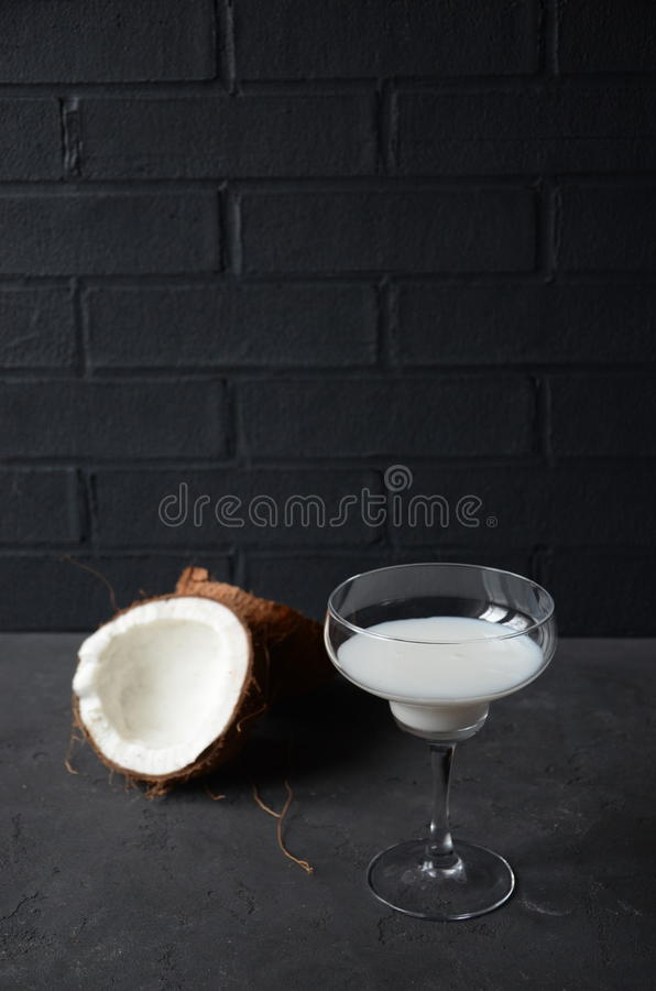 Download Pina Colada Drink In Cocktail Glass Decorated With Coconut And Orhid Flowers Stock Photo - Image of beverage, orhid: 83700980