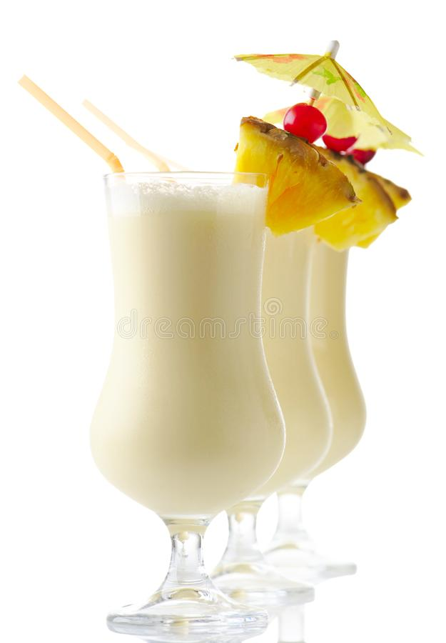 Pina colada summer drinks with piece of pineapple isolated on white royalty free stock photos