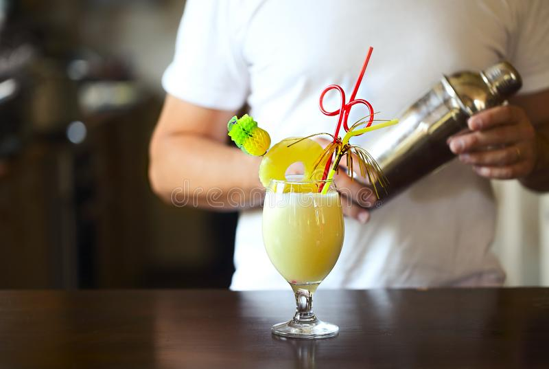 Pina Colada. Yellow alcohol cocktail with pineapple, lemon, cold vodka filled with crushed ice in a beautiful cocktails glass on a stock image