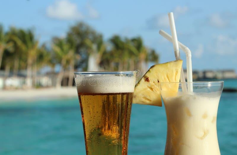 Pina Coladas on the beach royalty free stock photography