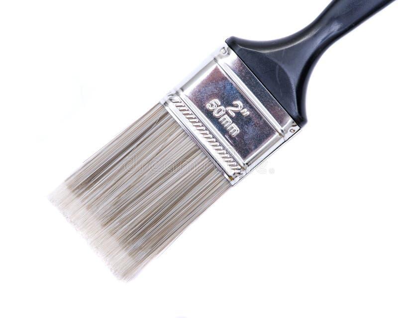 Pinceau de service de coupe plate d'isolement sur le blanc photographie stock