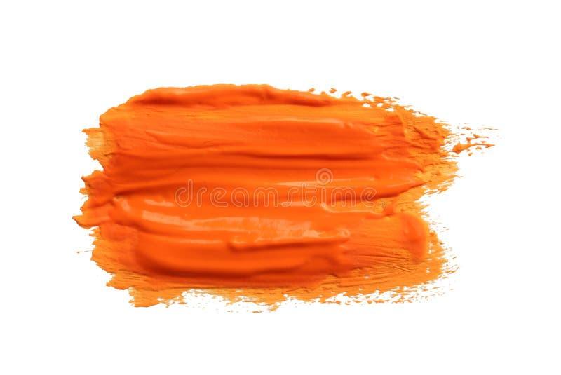 Pincelada abstracta de la pintura anaranjada fotos de archivo