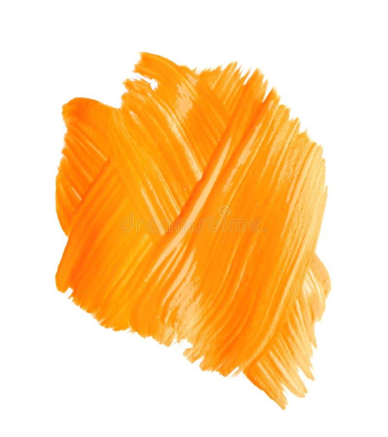 Pincelada abstracta de la pintura anaranjada aislada en blanco imagen de archivo libre de regalías