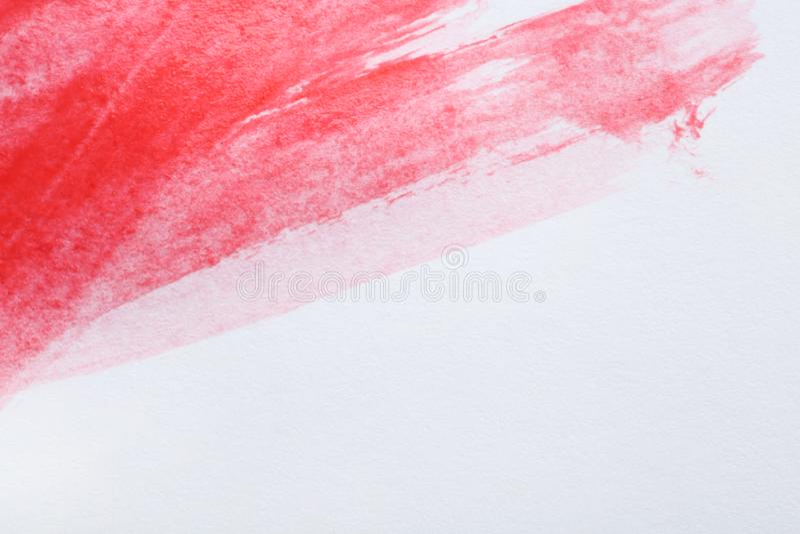 Pincelada abstracta de la pintura roja en blanco Espacio para el texto imágenes de archivo libres de regalías