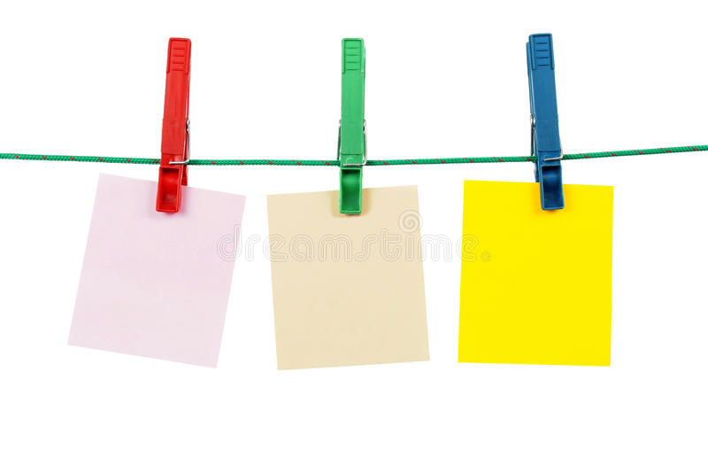 Pinces à linge avec les cartes vierges de message photo libre de droits