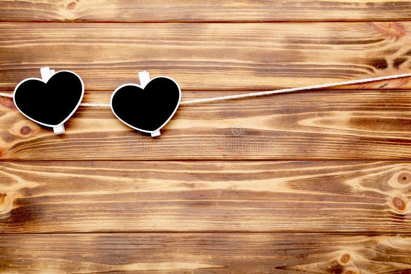 Pinces à linge dans la forme du coeur image stock