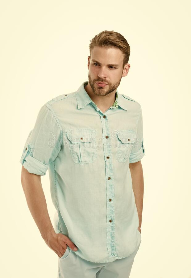 A pinch of genuine style. Caucasian guy wearing casual summer style isolated on white. Handsome man with unshaven face stock photography