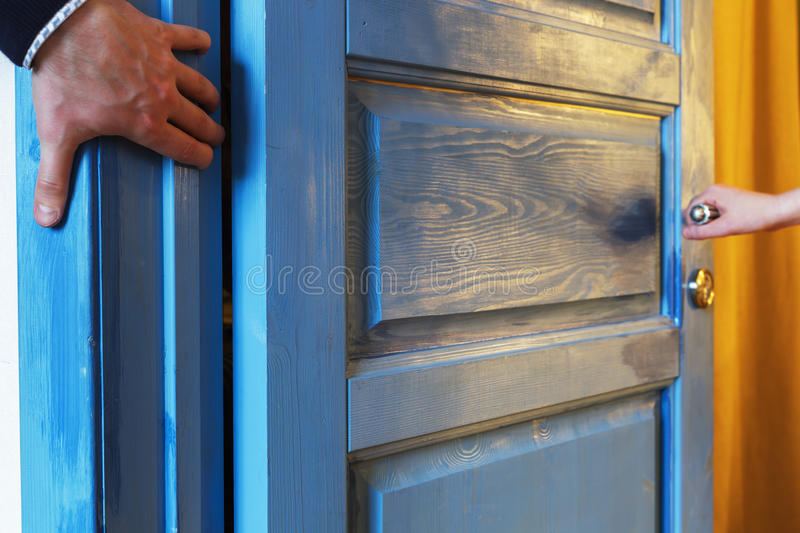 Pinch your fingers in the door. Man inadvertently pinched his hand in the door royalty free stock images